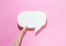 Speech bubble on a pink background. Speech bubble on a bright pink background royalty free stock image