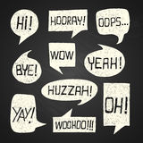 Speech bubble set with short phrases on chalkboard background 1 royalty free stock photos