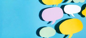 Speech bubble theme text messaging theme. Speech bubble text message theme with hard shadow on a blue background stock photo