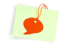 Speech bubbles on blank note Royalty Free Stock Photography
