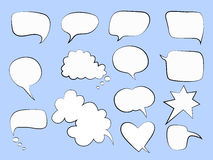 Speech bubbles on a blue backgroung Royalty Free Stock Image