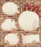 Speech bubbles on brick wall texture Stock Photography