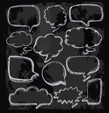 Speech bubbles on chalkboard Stock Photos