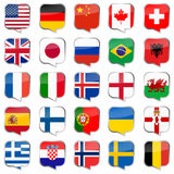 Speech bubbles with country flags Royalty Free Stock Photography