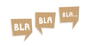 Speech bubbles cut out of carton with words Bla bla bla. Speech bubbles cut out of craft paper or cardboard with words Blah blah blah Royalty Free Stock Image
