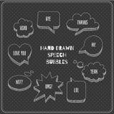 Speech bubbles doodles in blackboard Stock Photography
