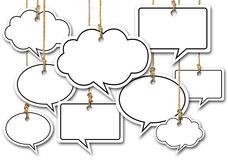 Speech Bubbles Hanging on White Background Royalty Free Stock Photography