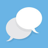 Speech Bubbles Overlapping. Two blank speech bubbles overlapping with blue background Stock Image
