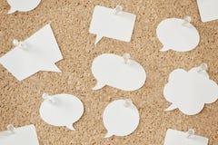 Speech bubbles on pinboard. Speech bubbles on cork pinboard Royalty Free Stock Photo