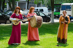 Speech by ensemble with ancient folk musical instruments stock photos
