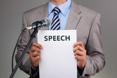 Speech with microphone Stock Image