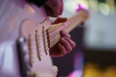 Speech by musicians on stage. Hands and musical instrument closeup. stock image