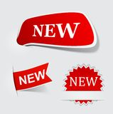 Speech red NEW paper labels. Royalty Free Stock Photos