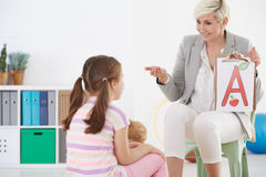 Speech therapist and child Royalty Free Stock Image