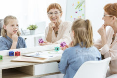 Speech therapist and little girl Royalty Free Stock Photography