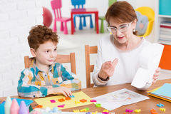 Speech therapist and little patient Royalty Free Stock Photography