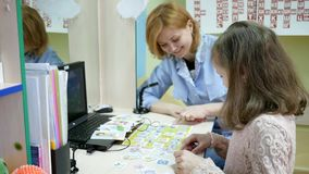 Speech therapist treats child, reception children`s doctor, Development of speech language, correct pronunciation