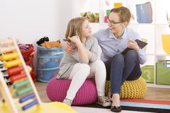 Speech therapist working with child stock photo