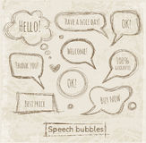 Speech and thought bubbles on vintage paper. Stock Photo