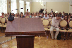 Speeches room with microphone Stock Images