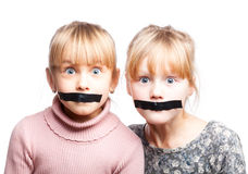 Speechless children with tape over mouths Stock Images