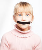 Speechless girl with tape over her mouth Stock Photos