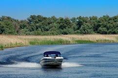 Summer landscape. Speed boat in Danube Delta, landmark attraction in Romania. Danube River Stock Images