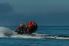 Speed motor boat transporting people on sea. stock photos