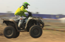 Speed. Cluj Napoca,Romania, 11 April 2009 -Panning image of a man riding fast an ATV during the Can-Am Vaneaza Lupul 2009 race Stock Photo