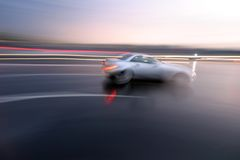 Speed. Fast moving sporty car, blurred motion Royalty Free Stock Photo