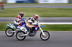 Speed. Motorcycle racing through the finish line Stock Image