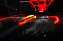 Speed. Ing down a road at night from a drivers perspective royalty free stock photos