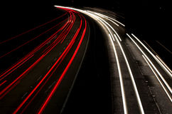 Speed. Cars at night, two lanes Royalty Free Stock Image