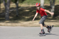 Speed. Boy skating on the rollerblades Royalty Free Stock Photos