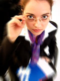 Speed. Portrait of a young business woman. A blur effect has been applied for more dynamism. Regular version is also available stock photo