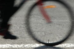 Speed. Riding a bike. Front wheel in close-up. It seems to be translucent because of blur Royalty Free Stock Photo