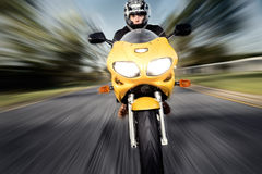 Speed. Motorbike rider with motion blur in background Stock Photography