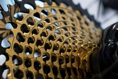 12 speed bicycle MTB chain casette - gold. Slovakia. Zilina, Slovakia; 10-Jun-2018. 12 speed bicycle MTB chain casette - gold. Slovakia stock photo