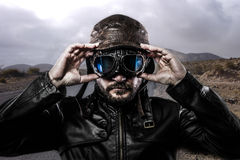 Speed biker with black leather jacket Stock Images
