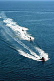 Speed on the blue sea. Jetski racing on a blue water background Royalty Free Stock Photography