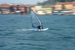 Speed blur. Speeding windsurfer with blurred background stock images