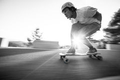 Speed blur fast longboard downhill skater Royalty Free Stock Images