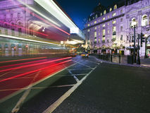 Speed blur of London bus. In piccadilly circus at night Stock Photos