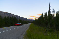 Speed. A Blurred Car Moving through the Canadian Rocky Mountains in Kootenay National Park on Highway 93 Stock Photos