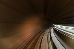 Speed blurred motion of train or subway train moving inside tunn Stock Images