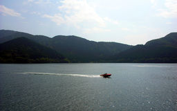 Speed boat. There is a speed boat on the lake stock photography