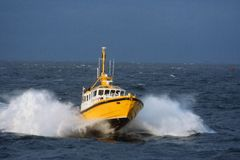 Speed boat. Pilot speed boat on a agitated sea Stock Images