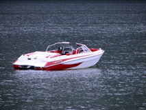 Speed boat. A red and white speed boat at anchor in the lake Stock Photo