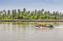 Speed boat. Along the tropical coconut garden Royalty Free Stock Photo