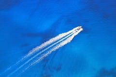 Speed boat on the azure sea Stock Photos